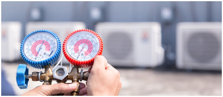 air conditioning technician testing equipment